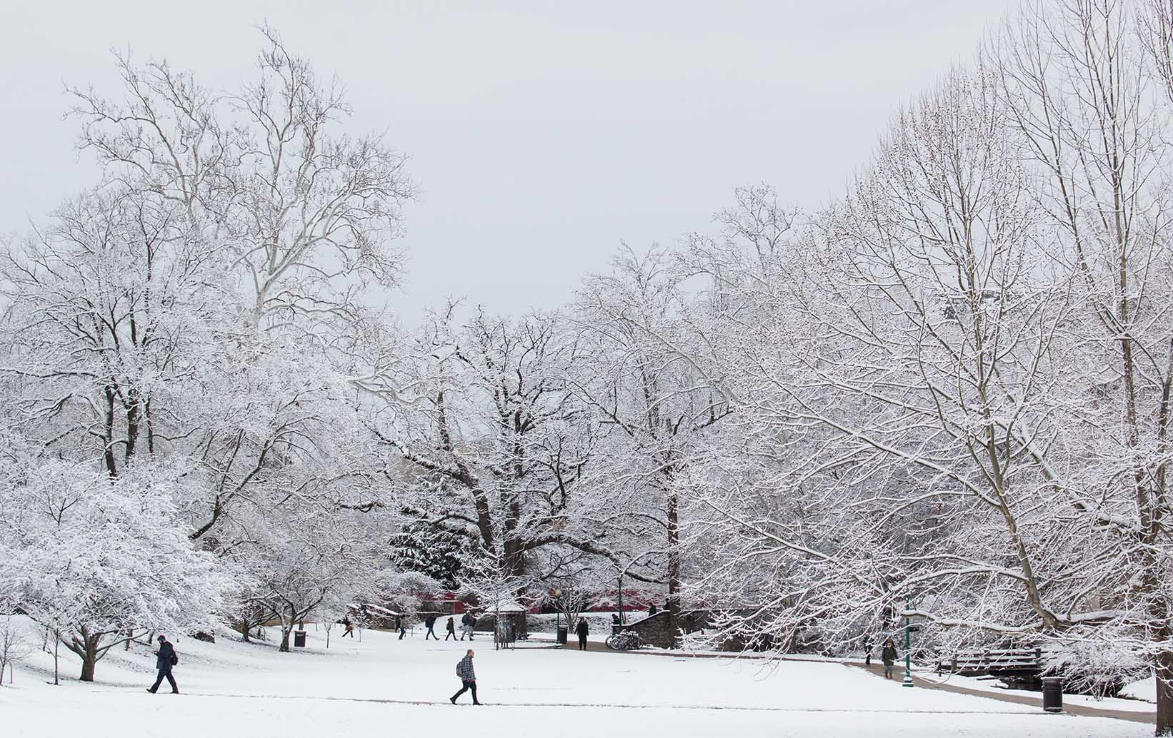 Snowy campus with students